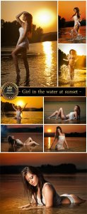 Girl in the water at sunset - stock photos